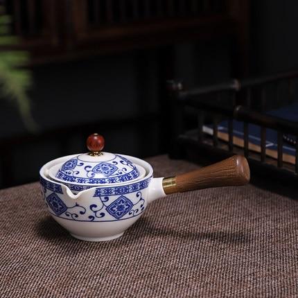 Palesa e Khabisang e Phethahetseng ea China Gongfu Kung Fu Tea e Behiloeng ka Ceramic Teapot W Wooden Handle Side